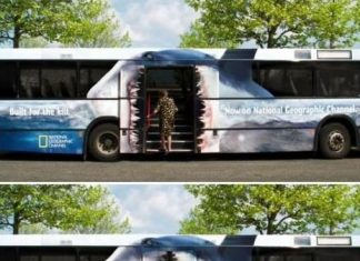 Man steps onto bus with shark mouth opening with doors.